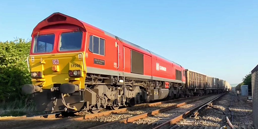 DB Cargo Class 59 number 59206 hauls a rake of JNA and JYA box wagons